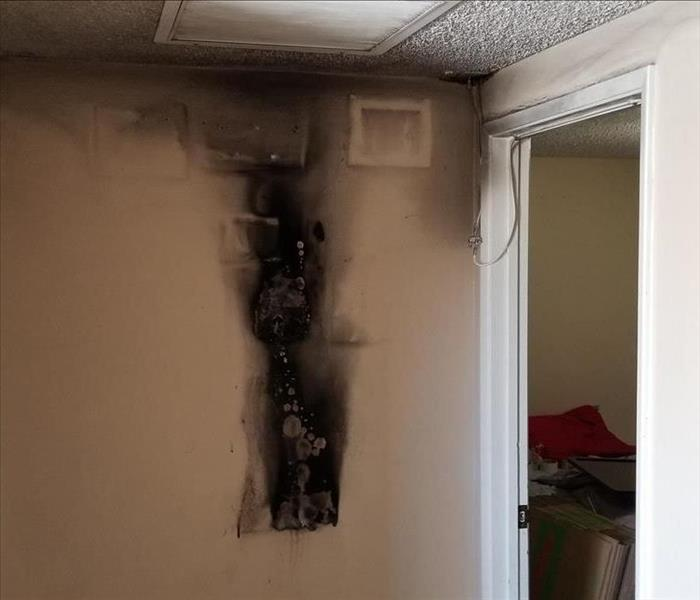 Fire Damage Originating In Hallway Before