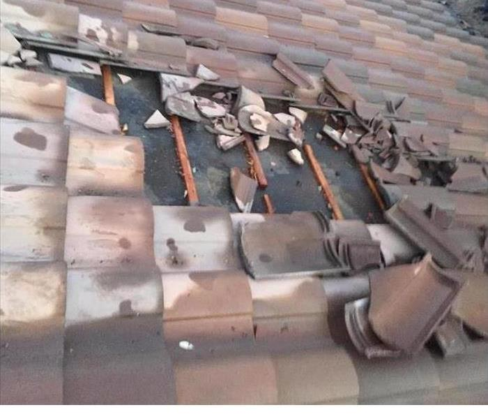missing roof tiles from high winds
